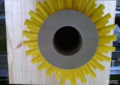 Brosse à grain rotative hélicoïdale